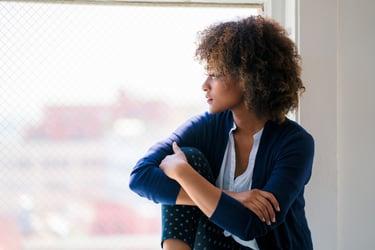 woman-looking-window